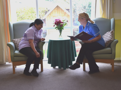 A member of our senior care team discussing tasks with our housekeeper